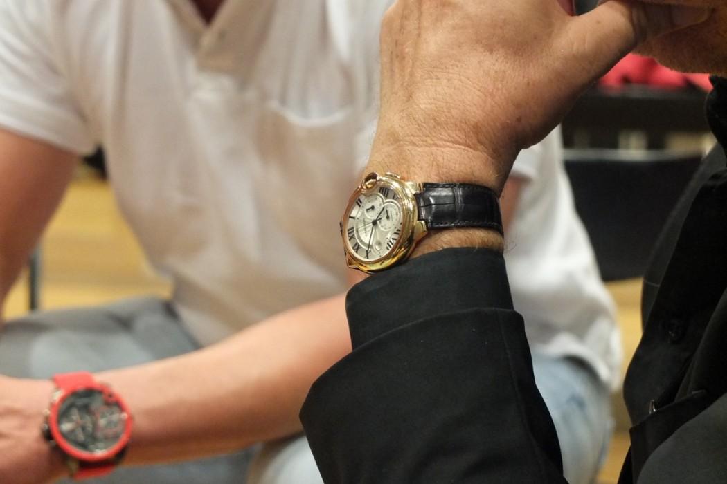 die Uhr des Unternehmers, eine Cartier.